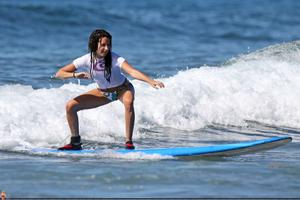http://img289.imagevenue.com/loc474/th_746244665_45429_ashley_tisdale_surfing_in_hawaii_on_december1_122_474lo.jpg