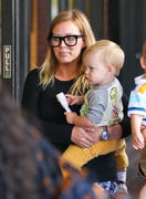 http://img289.imagevenue.com/loc500/th_910625554_Hilary_Duff_Babies_First_Class6_122_500lo.jpg